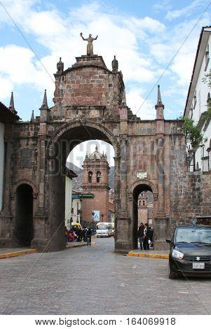 Cusco Peru - December 14 2016: Santa Clara Arch framing Santa Clara Church in Cusco Peru on December 14 2016