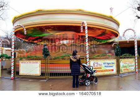 A spinning Carousel in a Christmas Market on the South Bank of the River Thames, London, England December 2016