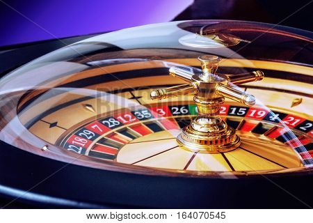 High contrast image of casino roulette luck wheel risk fortune lucky