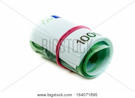One hundred euro banknotes roll with rubber isolated on white