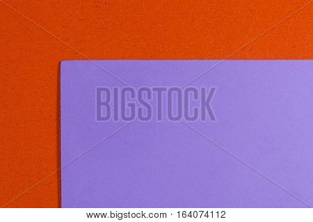 Eva foam ethylene vinyl acetate smooth violet surface on orange sponge plush background