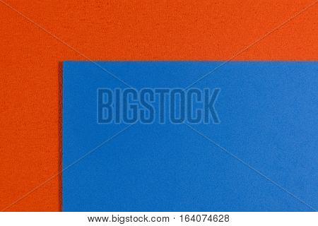 Eva foam ethylene vinyl acetate smooth blue surface on orange sponge plush background