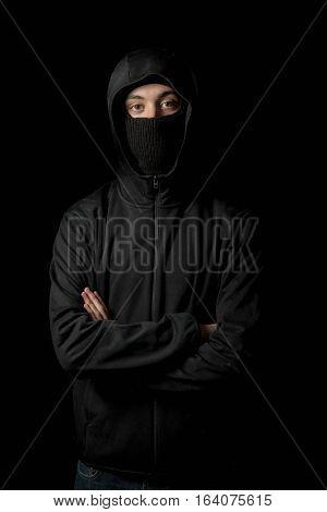 Hooden caucasian man wearing a balaclava mask