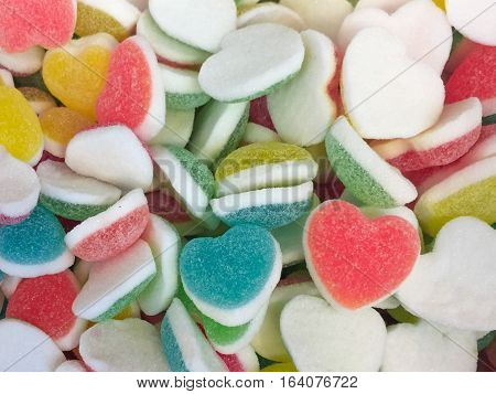 Colorful Heart Shape Jelly Candy Bonbon Snack Group. Sweet For Valentines Day Background. Pastel Col