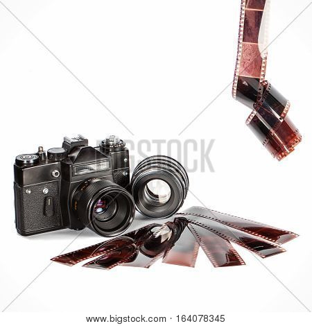 Old film camera and film. Isolation on a white background. Vintage. The camera of the last century