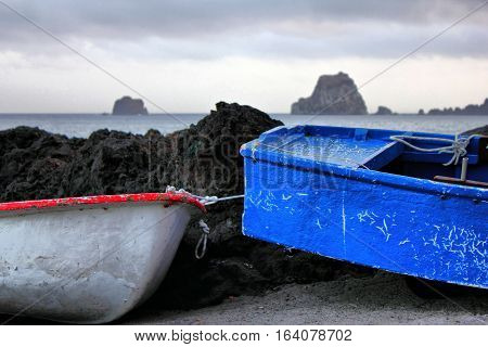 Fragment of two old boats with the ocean in the background on the island of El Hierro