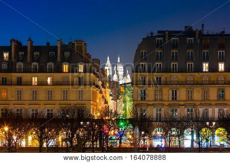 Night view of Sacre-Coeur Basilica or Basilica of the Sacred Heart of Jesus, seen from Tuileries Garden, Paris, France