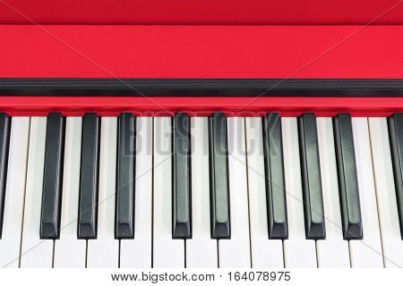 Black and white piano klachishi red close-up as background