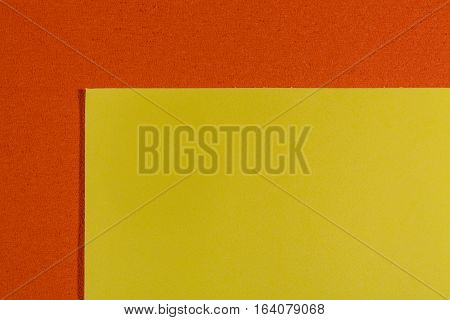 Eva foam ethylene vinyl acetate smooth lemon yellow surface on orange sponge plush background