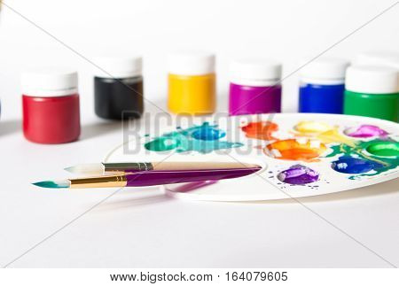 Different Size Paint Brushes And Color Palette