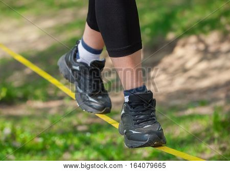 Tightrope Walker Is On A Tight Sling, Which Is Fixed On The Trees, At A Low Altitude. Slasklining Ex