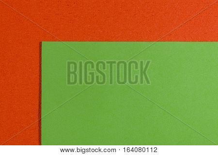 Eva foam ethylene vinyl acetate smooth apple green surface on orange sponge plush background