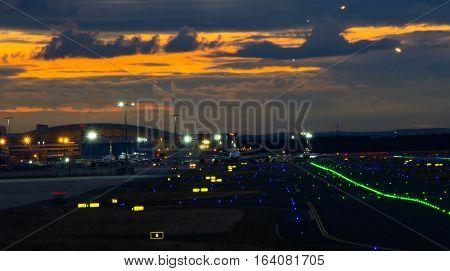 Frankfurt am Main - October 07 2016: Frankfurt International Airport runway illuminated at night. October 7 2016 in Frankfurt am Main Germany