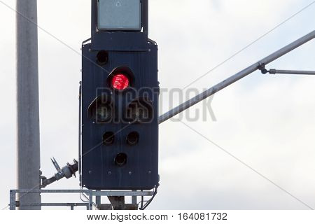 german rail road sign with a red light