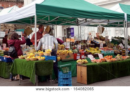 Basingstoke, Uk - Jan 04 2016: Unidentified Market Traders And Customers At A Fruit And Vegetable St