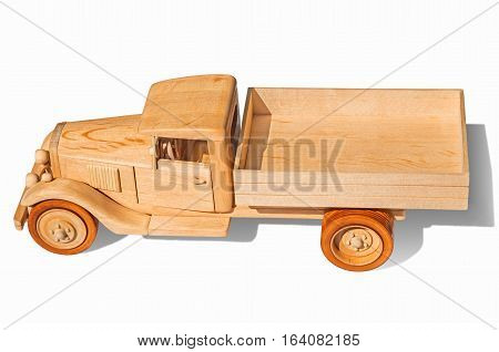 Wooden model of retro freight car on a white background