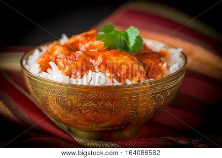 Delicious Indian butter chicken served with basmati rice.