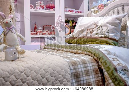 The bed in the children's bedroom closet with toys and gifts