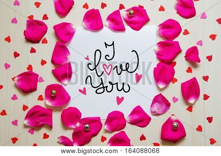 St Valentine's Day vintage composition of greeting note with hand drawn lettering and rose petals