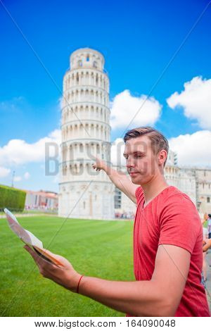 Young boy with toristic map on travel to Pisa.