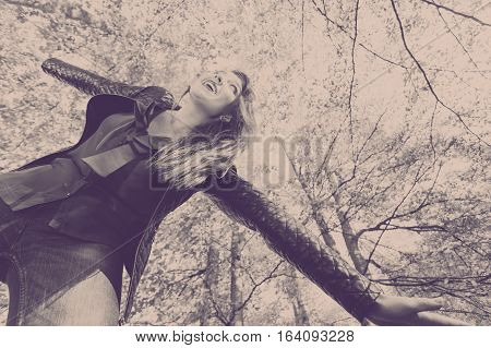 Woodland scenery fun relax leisure outdoor concept. Lady dancing in forest. Redhead girl throwing herself into passionate dance in autumnal park.