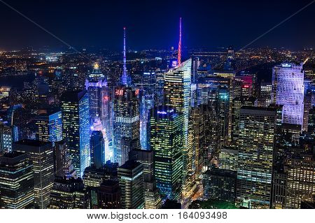 NEW YORK CITY USA - OCTOBER 5: New York Uptown and Times Square on October 5 2016 panorama aerial view at night with office building and skyscrapers skyline.
