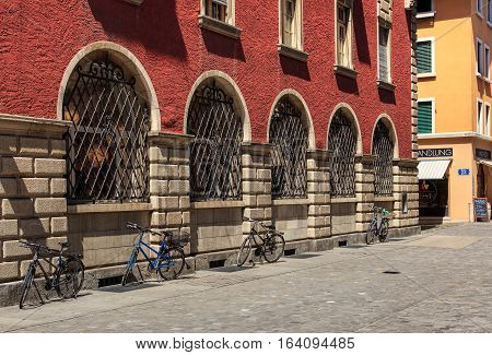 Aarau, Switzerland - 7 July, 2016: bicycles parked along a street in the old town. Aarau is a town and municipality in Switzerland, it is the capital of the Swiss Canton of Aargau.