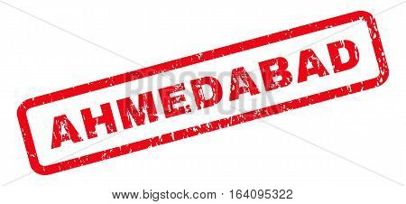 Ahmedabad text rubber seal stamp watermark. Tag inside rounded rectangular banner with grunge design and unclean texture. Slanted glyph red ink emblem on a white background.