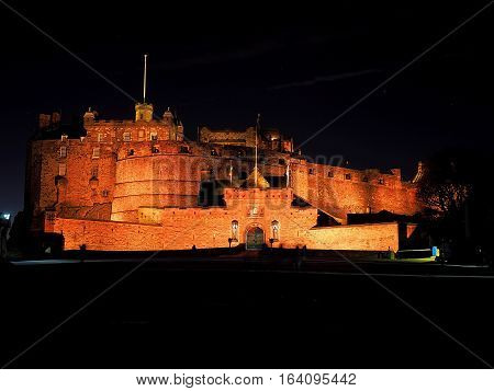 Edinburgh Castle in the night. Edinburgh, Scotland - December 19, 2016 Powerful medieval castle on a hill in the center of Edinburgh captured in the evening scenery.