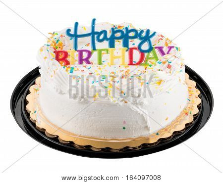 Birthday cake with white icing and colorful happy birthday plastic sign on the top