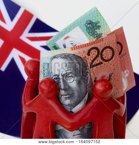 Australian dollar notes in a huddle with the Australian flag.
