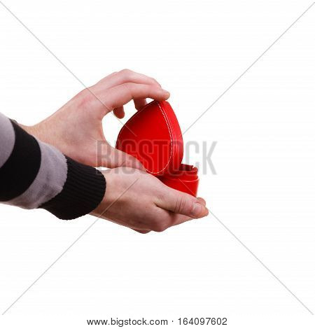 Holiday valentine day proposing concept. Man holding red heart shaped gift box in hand isolated
