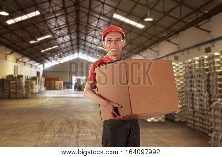 Young Asian Man Courier Carrying Package