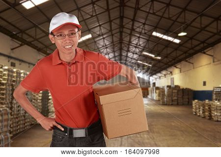 Smiling Young Asian Male Postal Delivery Courier