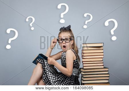 Girl  Reading A Book And Is Very Surprised
