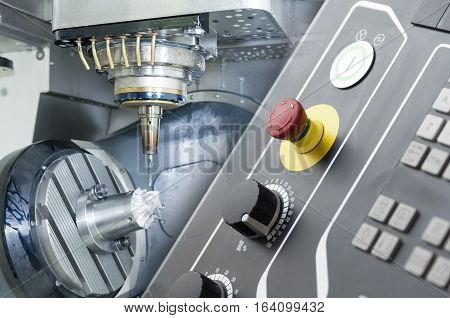 Abstract scene of the five axis CNC machine with the raw material work piece and the CNC's controller panel
