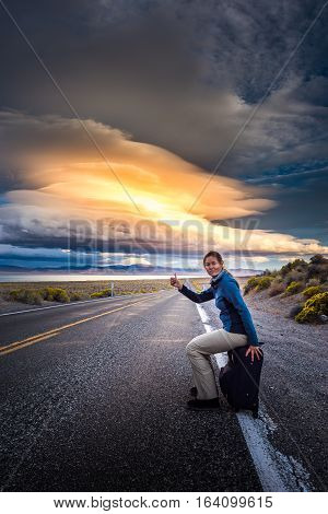 Hitchhiking On A Desert Road At Sunset