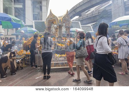 BANGKOKTHAILAND - DEC 31 : snapshot of tourist in Erawan shrine while new year festival on december 31 2016 Thailand. Erawan shrine is famously place in ratchaprasong area