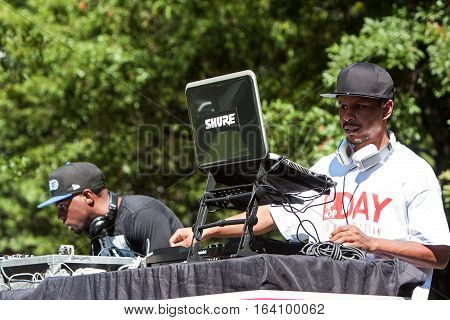 ATLANTA, GA - OCTOBER 2016: Two deejays use sophisticated electronics to enhance the audio and support the performers at the Atlanta Hip Hop Day in Woodruff Park in Atlanta GA on October 8 2016.