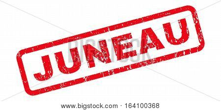Juneau text rubber seal stamp watermark. Tag inside rounded rectangular banner with grunge design and dust texture. Slanted glyph red ink sticker on a white background.