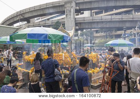 BANGKOKTHAILAND - DEC 31 : scene of Unidentified crowd worship in Erawan shrine in ratchaprasong area while new year festival on december 31 2016 Thailand. Erawan shrine is famous place for tourist