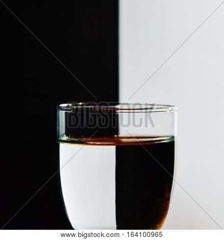 refraction on glass water in black and white background