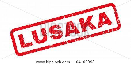 Lusaka text rubber seal stamp watermark. Caption inside rounded rectangular shape with grunge design and unclean texture. Slanted glyph red ink emblem on a white background.
