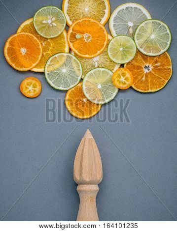 Mixed Fresh Citrus Fruits And Wooden Juicer For Summer Citrus Juice. Fresh Citrus Fruits Sliced Lime