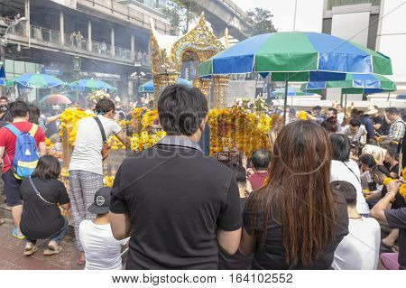 BANGKOKTHAILAND - DEC 31 : Unidentified person worship in Erawan shrine in ratchaprasong area on december 31 2016 Thailand. there are many tourist worship at Erawan shrine in new year festival