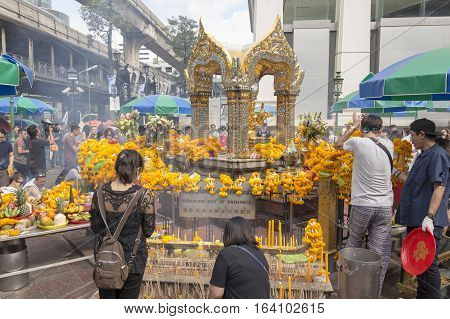 BANGKOKTHAILAND - DEC 31 : people worship at Erawan shrine in ratchaprasong area on december 31 2016 Thailand. there are many tourist worship at Erawan shrine in new year festival