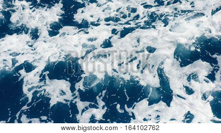 Restless foamy blue sea water from above
