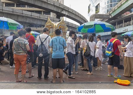 BANGKOKTHAILAND - DEC 31 : group of Unidentified people worship at Erawan shrine in ratchaprasong area on december 31 2016 Thailand. there are many tourist worship at Erawan shrine in new year festival