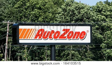 Mount Pocono, Pennsylvania, July 15, 2016: An Autozone sign is elevated by a pole at the parking lot of one of their stores.