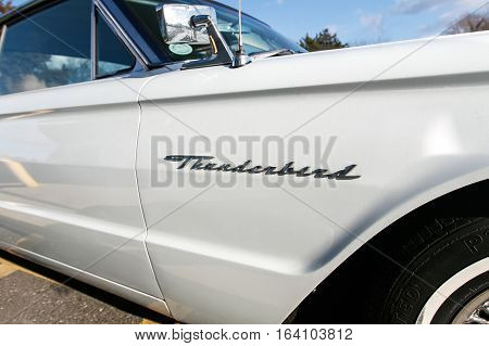 Absecon NJ December 10 2016: Closeup of a white 1964 Ford Thunderbird 390 Coupe.